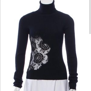 D&G semi-sheer turtleneck sweater and lace insert.